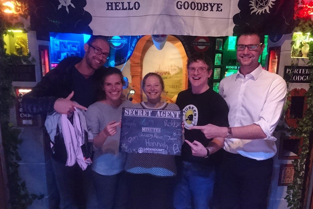 The Quizzly Bear posing with their record time of 40 minutes for the Halloween Secret Agent room