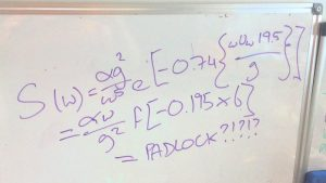 A whiteboard covered in maths equations equally PADLOCK?????