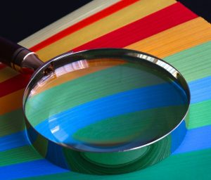 magnifying glass on some coloured paper