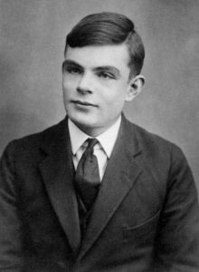 A passport photo of Alan Turing aged 16