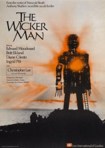 a movie poster for the horror film The Wicker Man showing a tall wicker structure with the sun behind it