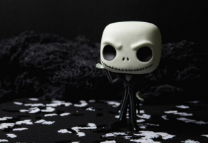 A plastic figure of Jack Skellington from the film The Nightmare Before Christmas, a skeleton wearing a pinstripe suit, on a black and white background