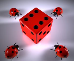 a red die surrounded by four ladybirds