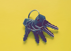 a bunch of keys on a yellow background