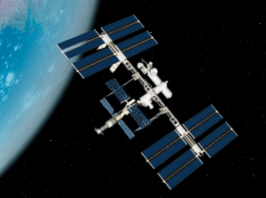 a space station with space and the edge of earth in the background