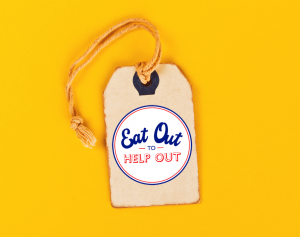 a price tag with the eat out to help out logo on it on a yellow background