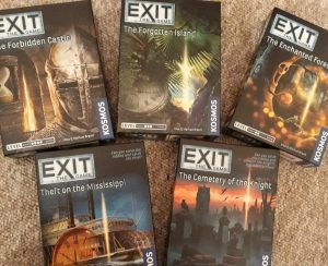 a selection of five exit games in their boxes