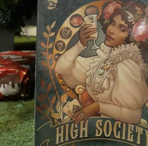 the board game high society, underneath a christmas tree