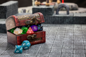 a box of dice for tabletop rpgs on a battlemap