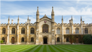 a scenic view of one of the cambridge colleges across the lawn